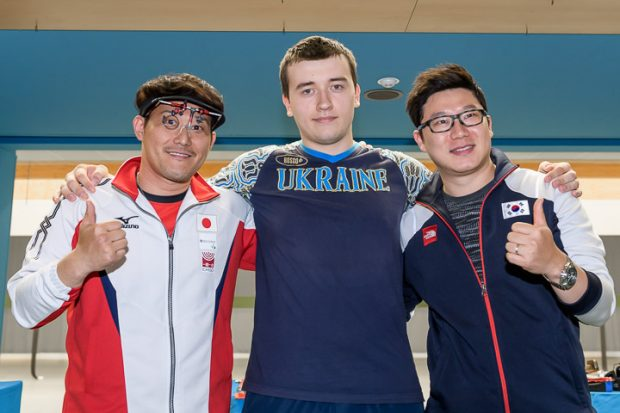 MUNICH - MAY 22: (L-R) Silver medalist Tomoyuki MATSUDA of Japan, Gold medalist Pavlo KOROSTYLOV of Ukraine and Bronze medalist Jongoh JIN of the Republic of Korea pose with their medals after the 10m Air Pistol Men Final at the Olympic Shooting Range Munich/Hochbrueck during Day 4 of the ISSF World Cup Rifle/Pistol on May 22, 2017 in Munich, Germany. (Photo by Nicolo Zangirolami)